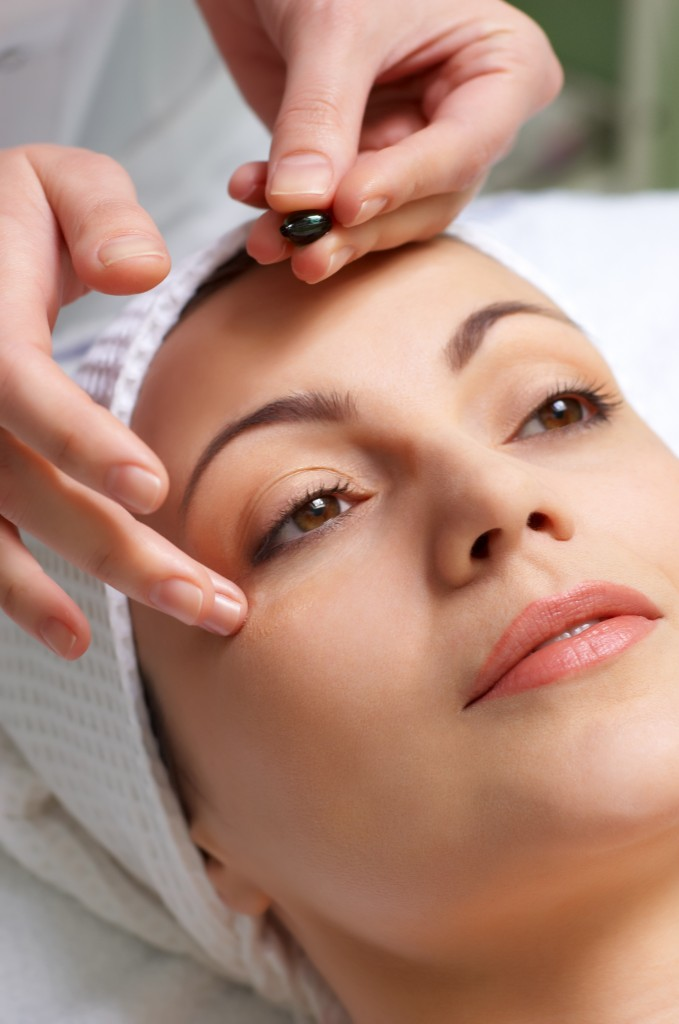 skin treatment applying face oil